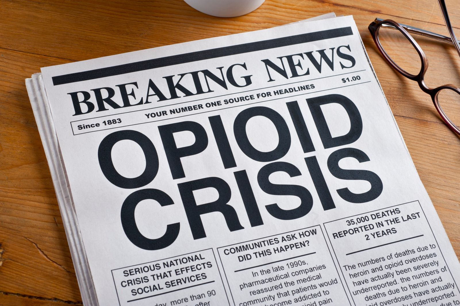 news paper with headline opioid crisis