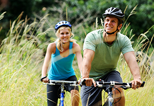 a male and female bike riding and smiling